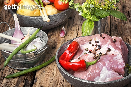Raw sirloin pork meat. Raw section meat. Piece of fresh pork meat with spices on old rustic table