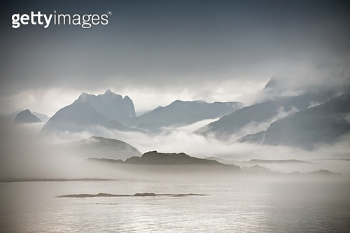 Coast of  Norway sea in clouds of fog. Cloudy Nordic day on Lofoten islands