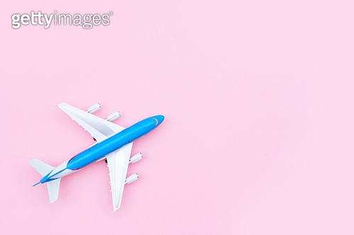 Plane model on pink background with copy space. Plane on pink