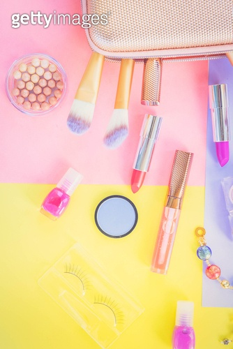 Colorful make up products with pursue pop art flat lay scene, retro toned. Colorful make up flat lay scene