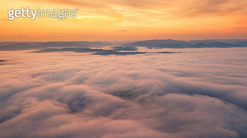 Beautiful foggy dawn in mountains. Sea of fog between mountain peaks. Carpathian mountains, Ukraine.