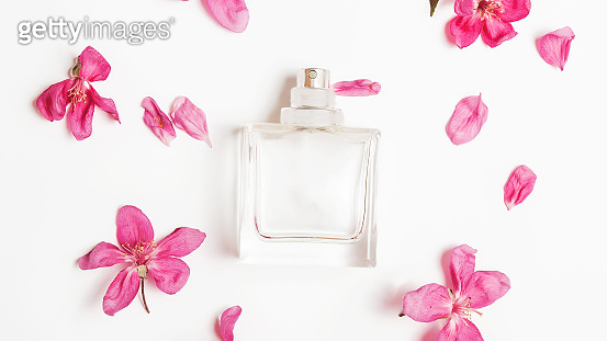perfume bottle and flowers on a white background. Stylish background for presentation of cosmetic products
