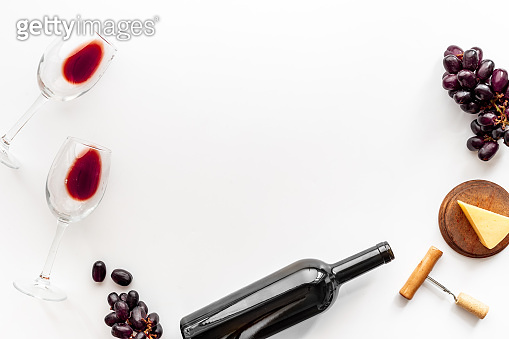 Set of wine bottle with glasses corkscrew and grape
