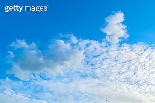 Sky background, blue evening sky, white colorful clouds