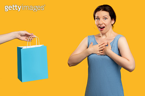 holiday surprise unexpected gift excited woman