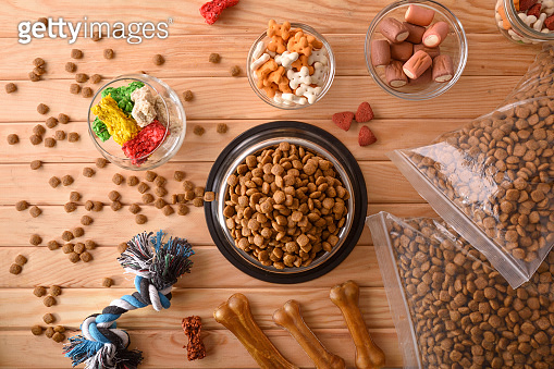 Background with various types of dry food for dog top