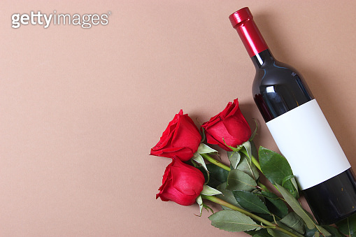 red wine and roses on the table. Valentine's day background.