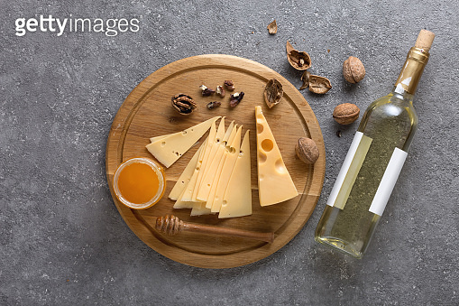 Wine tasting concept with traditional appetizers of cheese