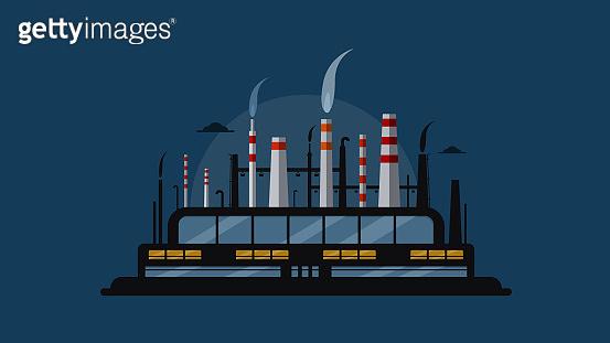 Night factory with smokestacks