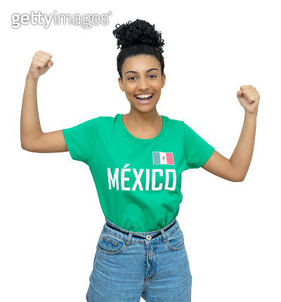 Cheering mexican young adult woman with football shirt