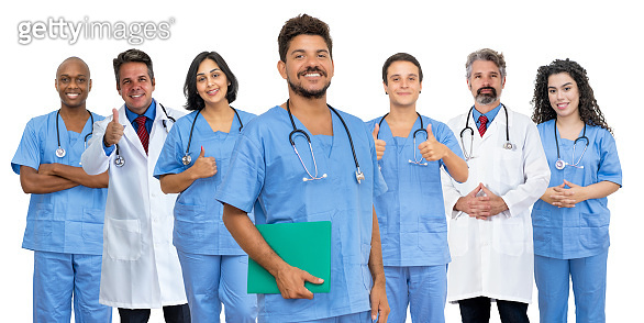 Handsome latin american male doctor with motivated medical team