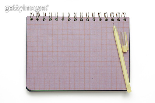 Purple spiral notebook with a pen cut out on a white background. To do list or reminder
