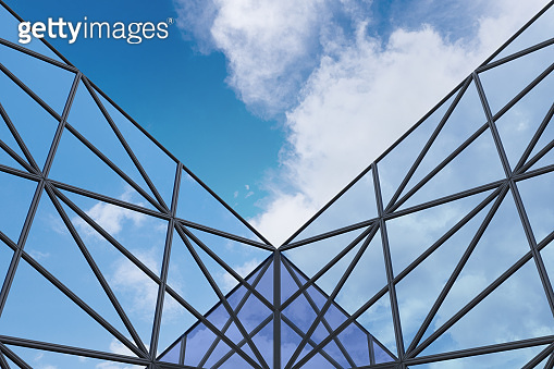 Low angle view of futuristic architecture, Skyscraper office building with cloud reflected on window, 3D rendering.