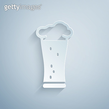 Paper cut Glass of beer icon isolated on grey background. Paper art style. Vector