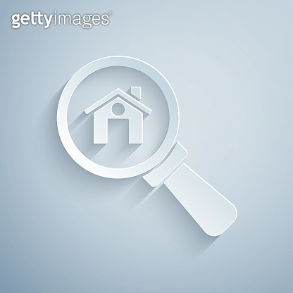 Paper cut Search house icon isolated on grey background. Real estate symbol of a house under magnifying glass. Paper art style. Vector