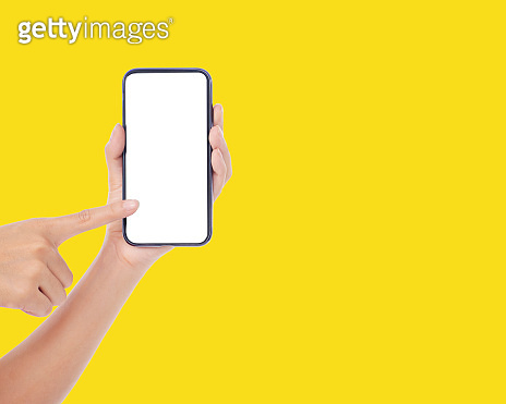 Woman holding smartphone white blank screen, mock-up