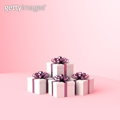 White gift boxes with purple ribbon, on pink background with empty copy space. Concept for women and holidays