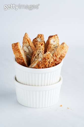 Italian Almond Biscotti Cantucci Biscuits, italian dessert cookies close up, selective focus, copy space. Homemade bakery confectionery concept.