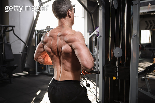 Mature male athlete working out at the gym