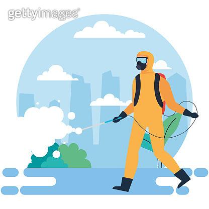 man at city disinfecting