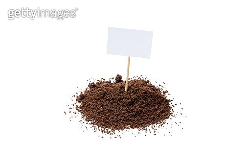 ground coffee powder isolated on white background. caffeine addiction concept. above view. roasted coffee cut out