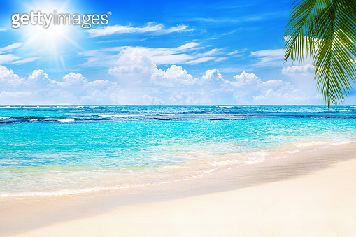 Tropical island landscape, exotic sand beach, turquoise sea water ocean waves, sun blue sky white clouds background, beautiful nature view, summer holidays, vacation, travel
