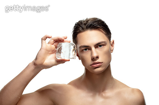 Portrait of young man isolated on white studio background. Caucasian attractive male model. Concept of fashion and beauty, self-care, body and skin care.