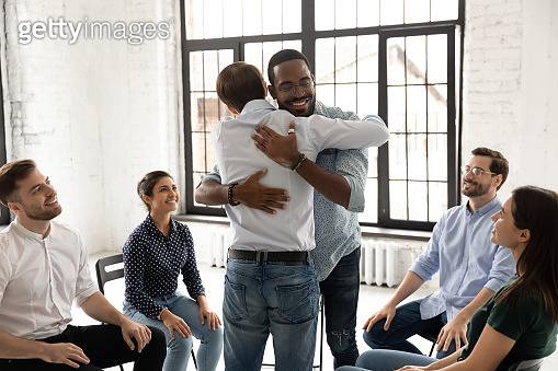 Diverse support community friends hugging on therapy meeting