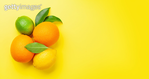 Fresh ripe citrus fruits on yellow background