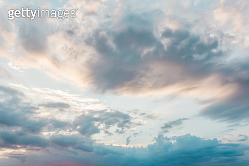 Blue sky with a pastel colored. Soft texture of fluffy clouds.