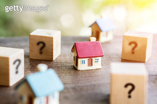 buy or rent real estate ,looking for new, right home concept with miniature house model with question mark