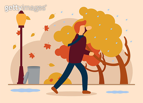 Vector autumn concept. A man in autumn clothes walks against the rain and strong wind, covering his face from the rain with his hand. Bad weather, strong wind, overflowing leaves. Lantern, trash can.