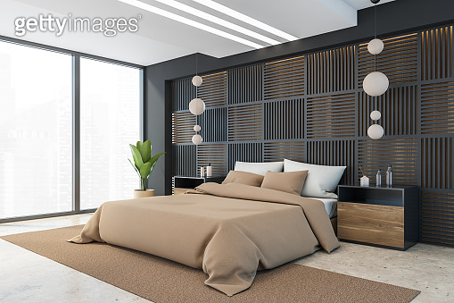 Black and beige bedroom with bed and window