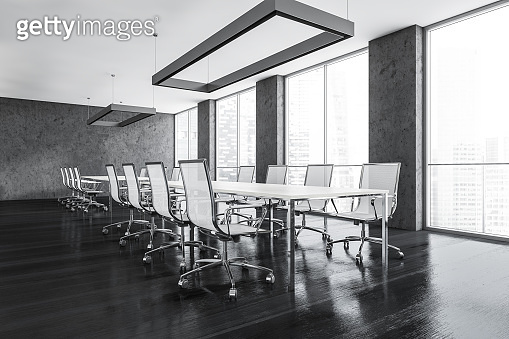 Black conference room with furniture near window in business office