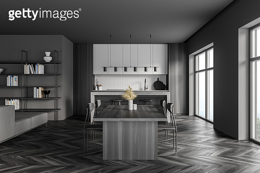 Dark grey kitchen with eating table and bookshelf, window and parquet
