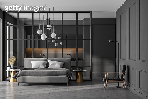 Grey living room with bed and linens, armchair on marble floor