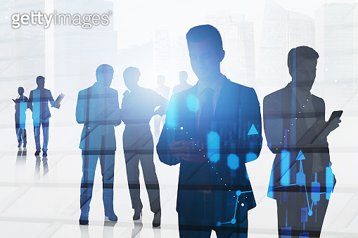 Business people in city and graph