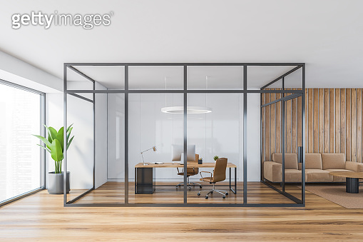 Wooden office consulting room behind glass doors near window