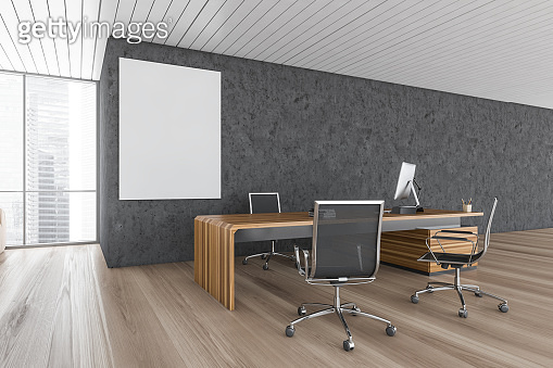 Mockup canvas in wooden and grey office room with furniture and computer