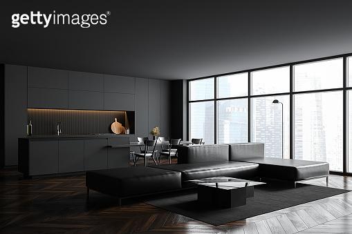 Modern gray living room corner with sofa and window