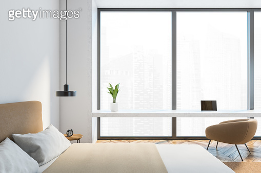 Light and wooden bedroom with window
