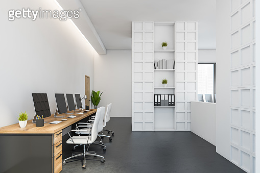 White and grey office room with shelves and furniture