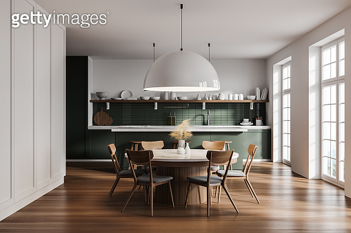 White and green kitchen interior with table