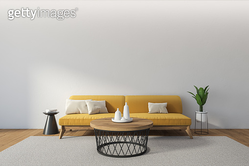 Copy space and yellow couch in living room interior with coffee table and plant