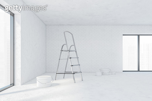 White empty hall for repairs, bucket of wall paint on the floor and stairs