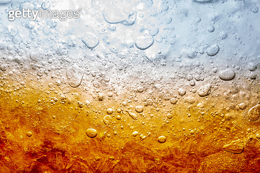 Macro soft drinks,Cola close-up,Ice, Bubble, Backgrounds, Ice Cube, Abstract Backgrounds,Ice cold drink,Detail of Cold Bubbly Carbonated Soft Drink with Ice