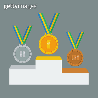 Gold, silver and bronze medals on white pedestal