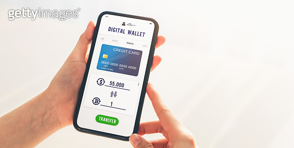 Hand using mobile phone for bitcoin to dollar exchange application. Smartphone screen display payment with credit card.