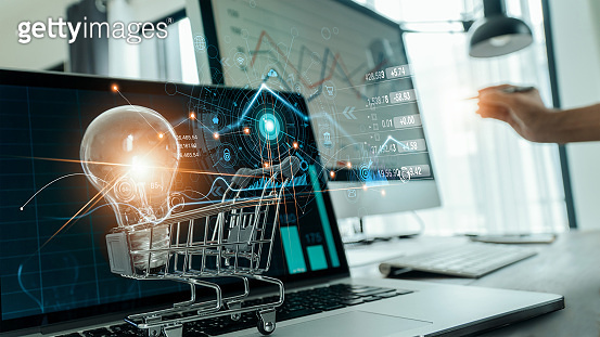 Abstract of digital marketing,  Glowing of light bulb in cart on laptop and icon digital marketing, Creative process and new idea, Strategy and planning of business, Online banking and payment.
