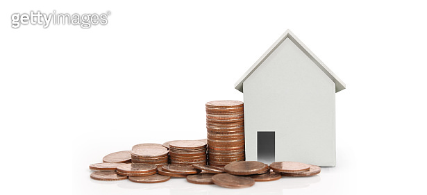 House Model and coins . Housing Real Estate concept. home business idea